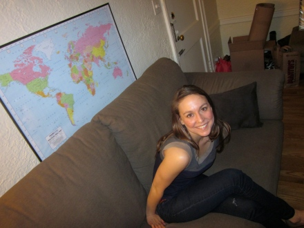 Me and a small glimpse of my apartment (plus the map of the world my boyfriend so graciously purchased for me at christmas time and framed for me 5 months later for my birthday because I am that lazy.)